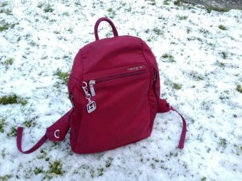 This is a Hedgren bag that's waterproof. I love it for its practicality - it also opens its main compartment from the back.