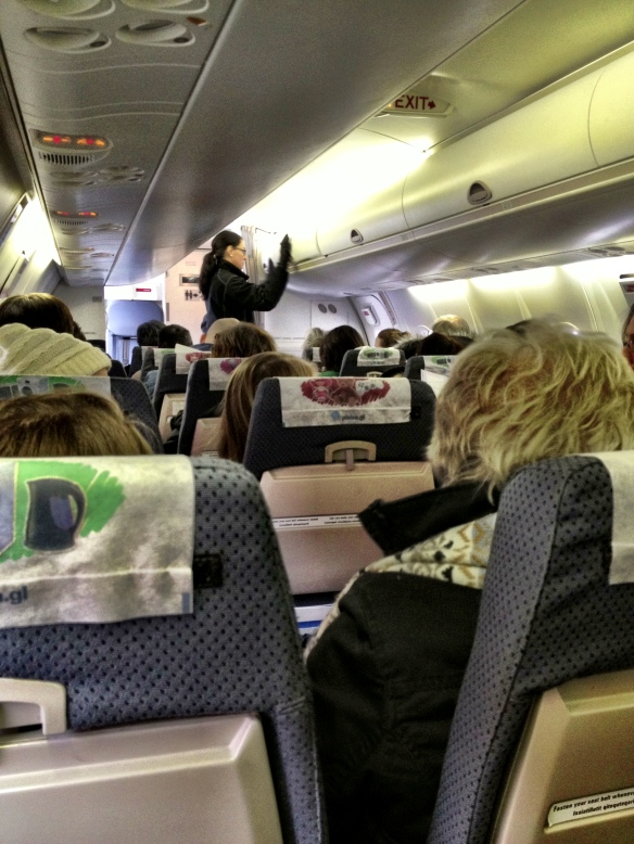 This photo was taken from the back seat. The air hostess standing up is at the very front of the plane!