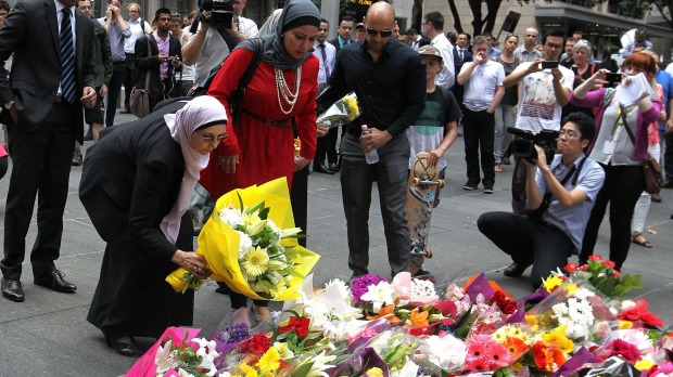 Members of the muslim community put flowers at Martin Place. Photo: Ben Rushton, SMH