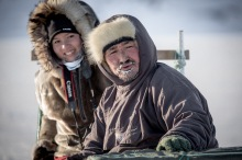 Tourist and Niels Lynge, an experienced dog sled driver.
